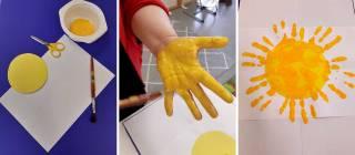 Auringon maalausta kädellä.